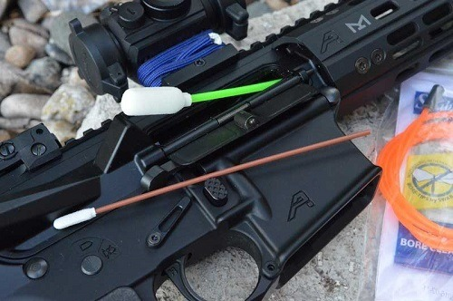 Cleaning Rifle With Cotton Swabs